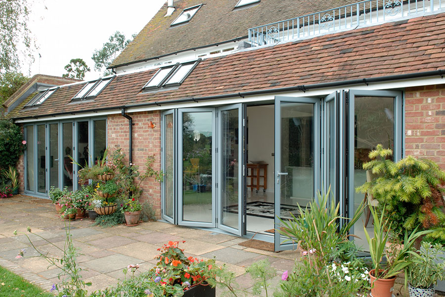 Grey aluminium and glass bifold door