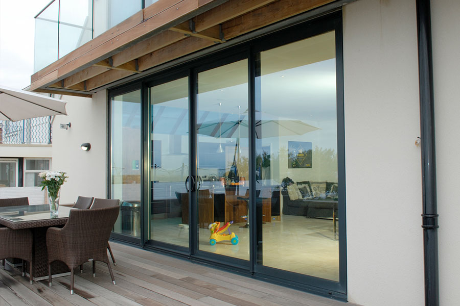 Aluminium sliding patio door leading out onto decking