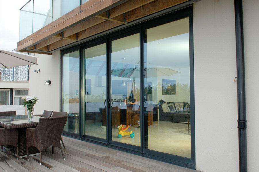 Aluminium sliding patio door leading out onto decking