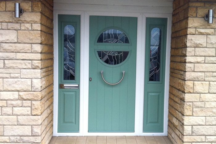 Chartwell green composite door with curved glass window and double side panels