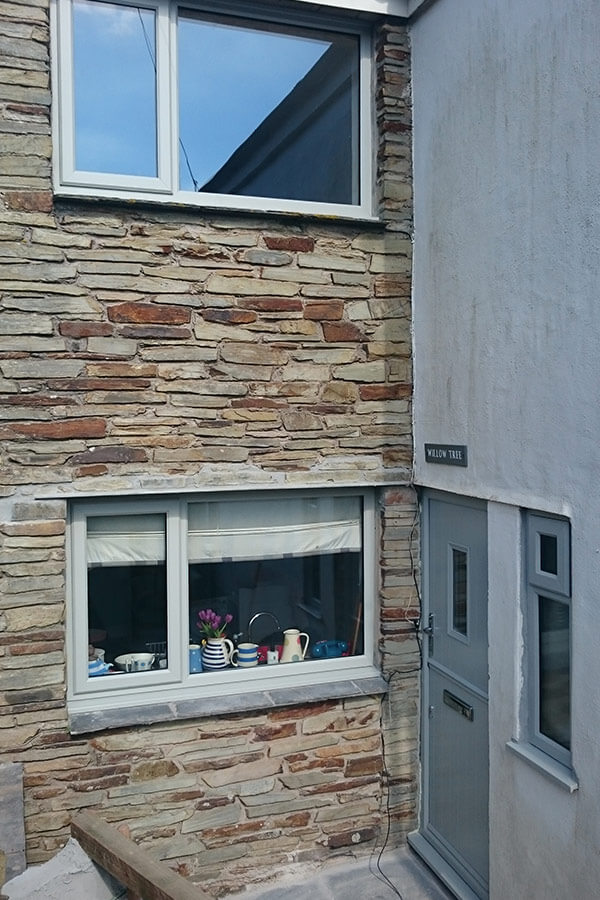 Grey composite stable door and grey uPVC casement windows