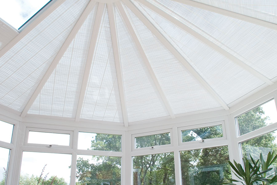 Conservatory with blinds for extra privacy and protection from the sun
