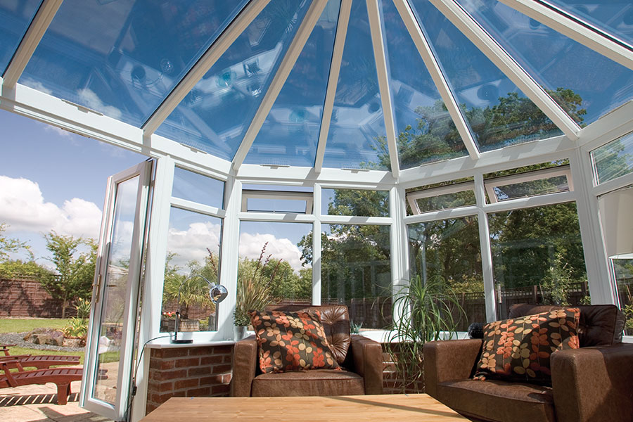 Conservatory installed with glazed roof and windows and uPVC french doors