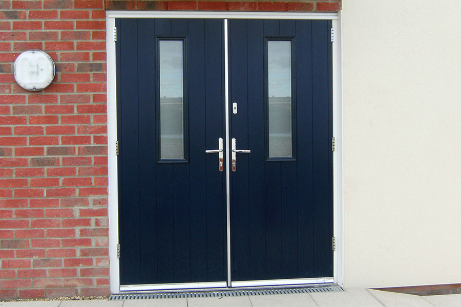 Dark blue double composite door with silver handles