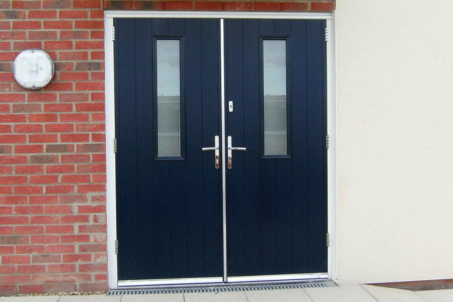 Dark blue double composite door with silver handles