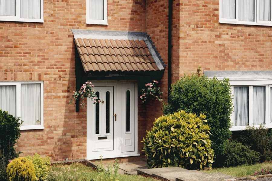 White uPVC entrance door with side panel