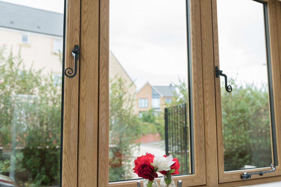 Residence 9 timber look uPVC windows with monkey tail handles