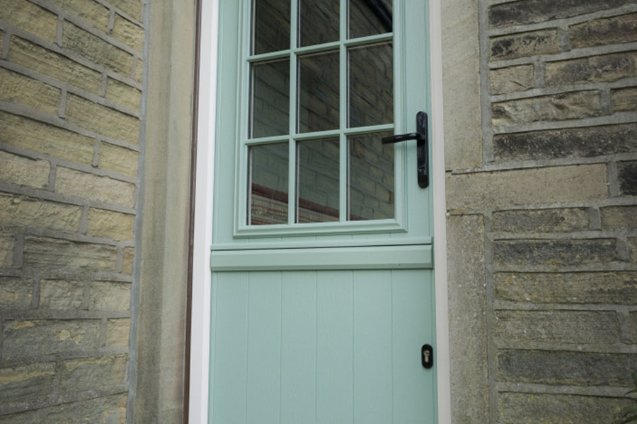 Composite door installed with black traditional hardware