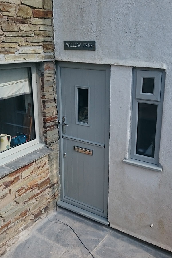 Grey composite stable door and uPVC windows