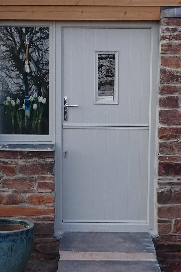 Grey composite stable door and grey uPVC window