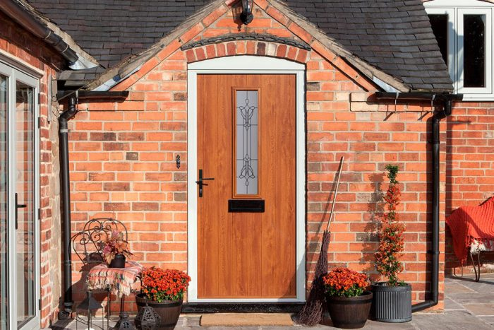 Oak colour composite door with traditional style handle and letterbox