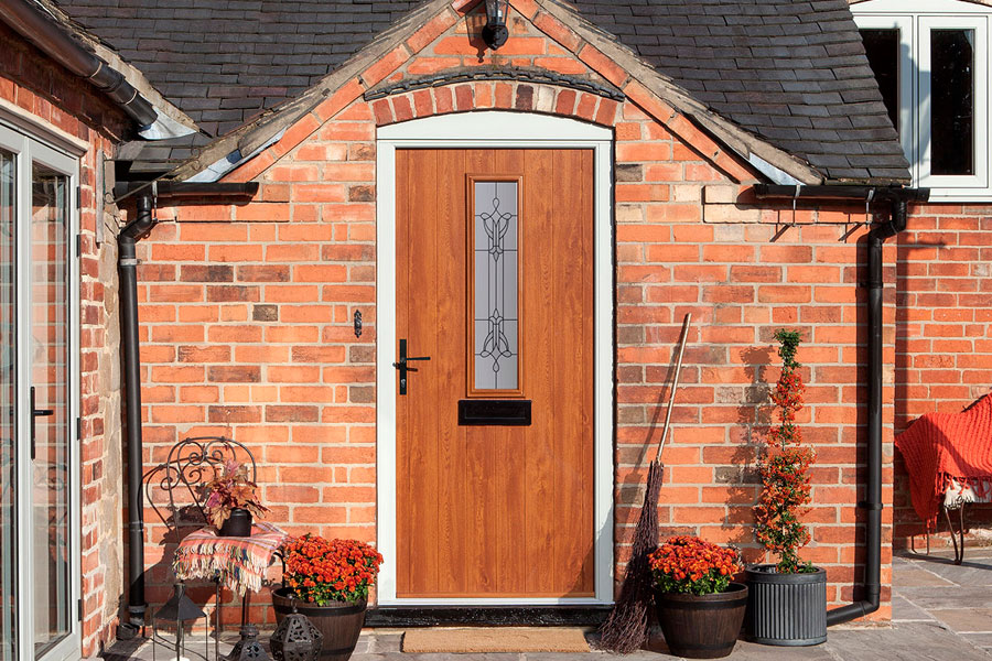 oak colour composite entrance door with traditional style hardware