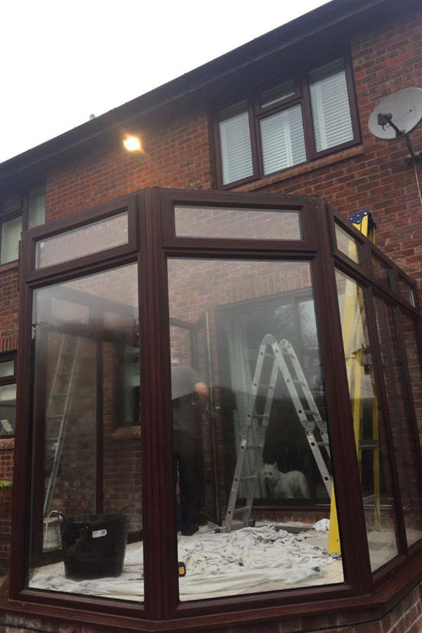 Conservatory glass roof installation old roof removed
