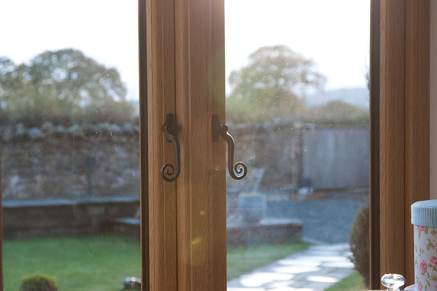 R9 casement window with monkey tail handles