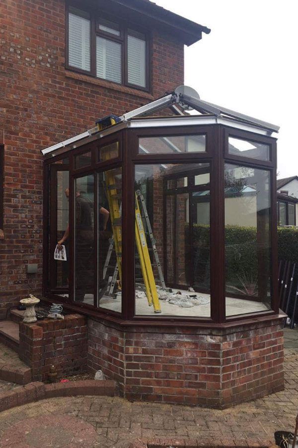 Conservatory glass roof installation frame completion