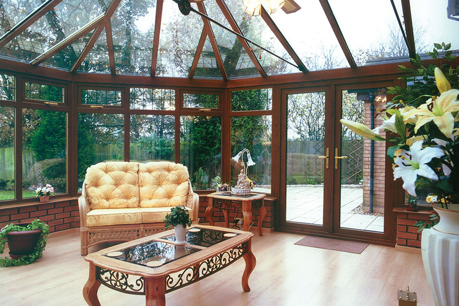 Rosewood colour conservatory with french doors