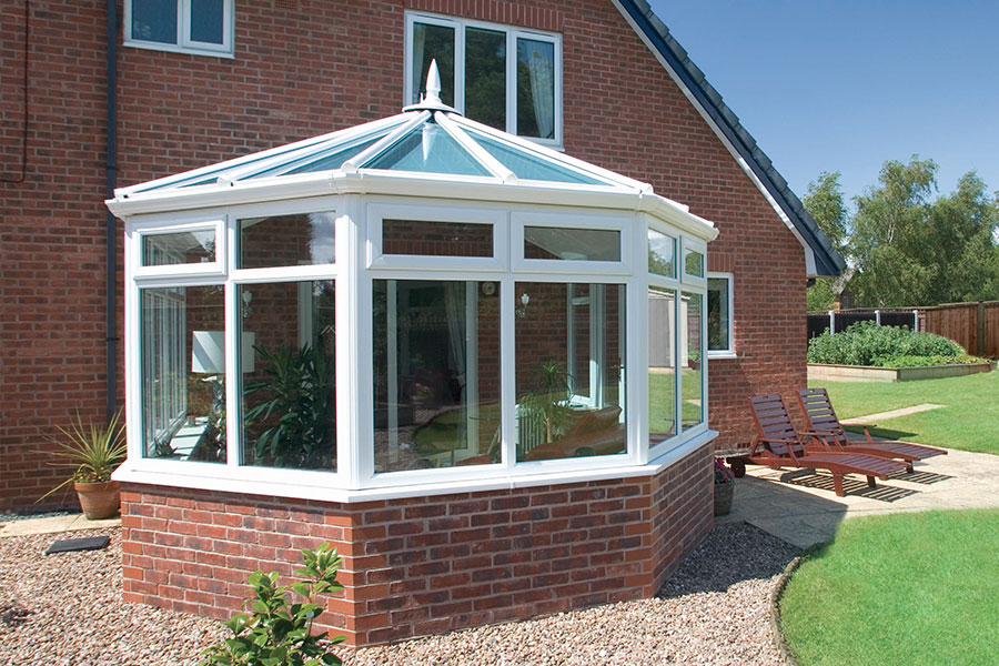 Victorian style conservatory with brick base and uPVC structure