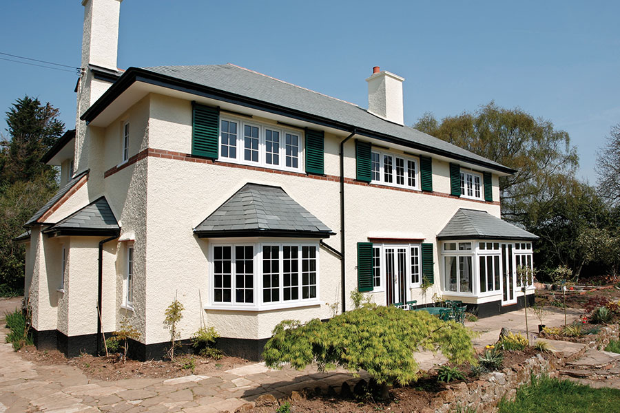 White aluminium windows with astragal bars