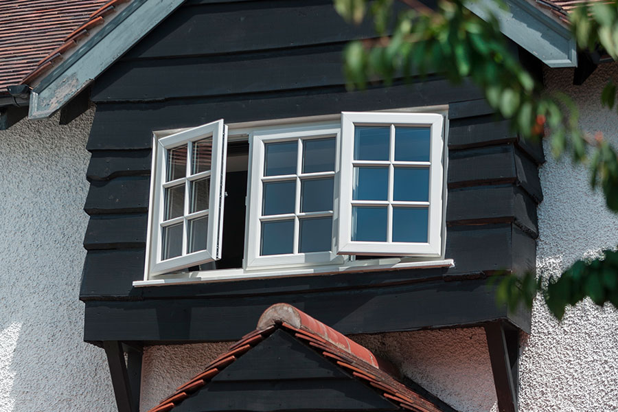 White casement window with astragal bars for traditional look