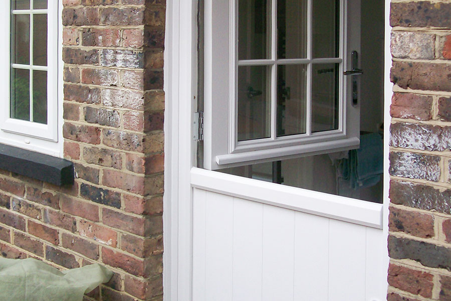 White stable door with astragal bars