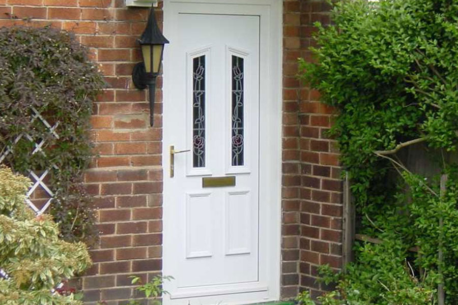 White uPVC entrance door with decorative glass