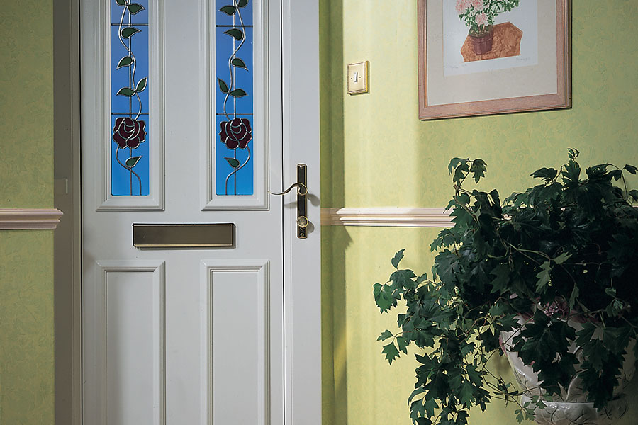 White uPVC entrance door with decorative detailing