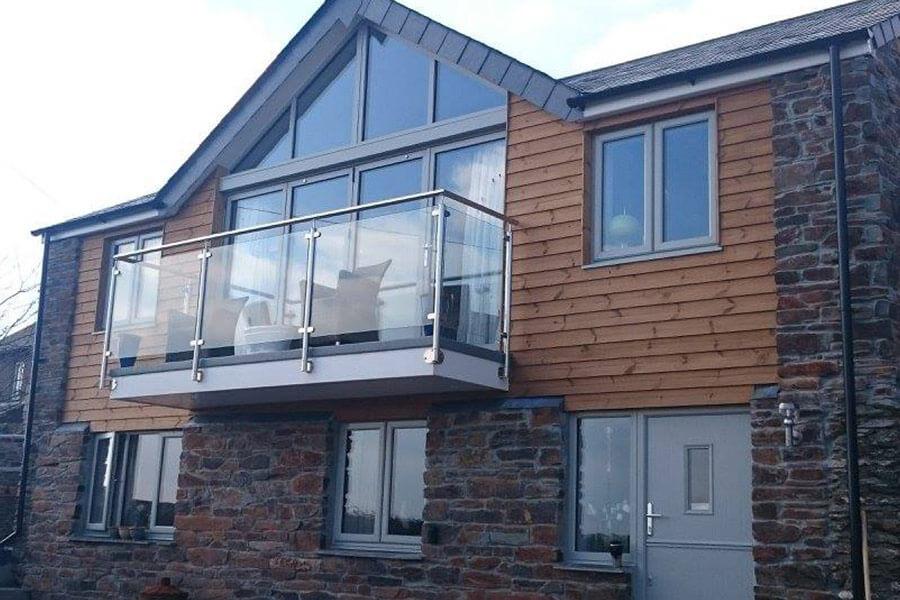 Grey uPVC casement windows and patio door balcony