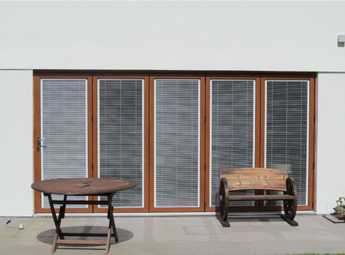 Bi-folding doors with integral blinds for increased privacy
