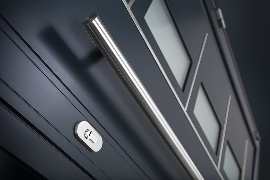 Grey aluminium entrance door with chrome bar handles