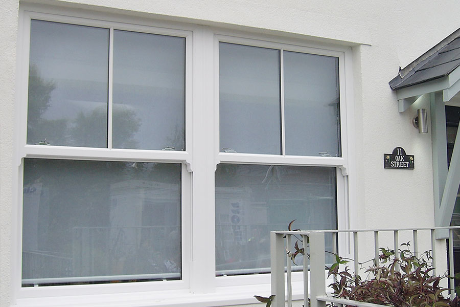White sliding sash windows with horns