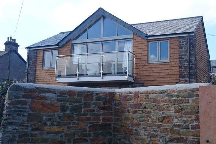 Grey uPVC patio door and casement windows
