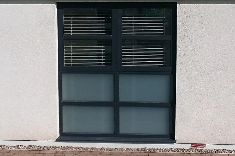 Black aluminium casement window with frosted glass