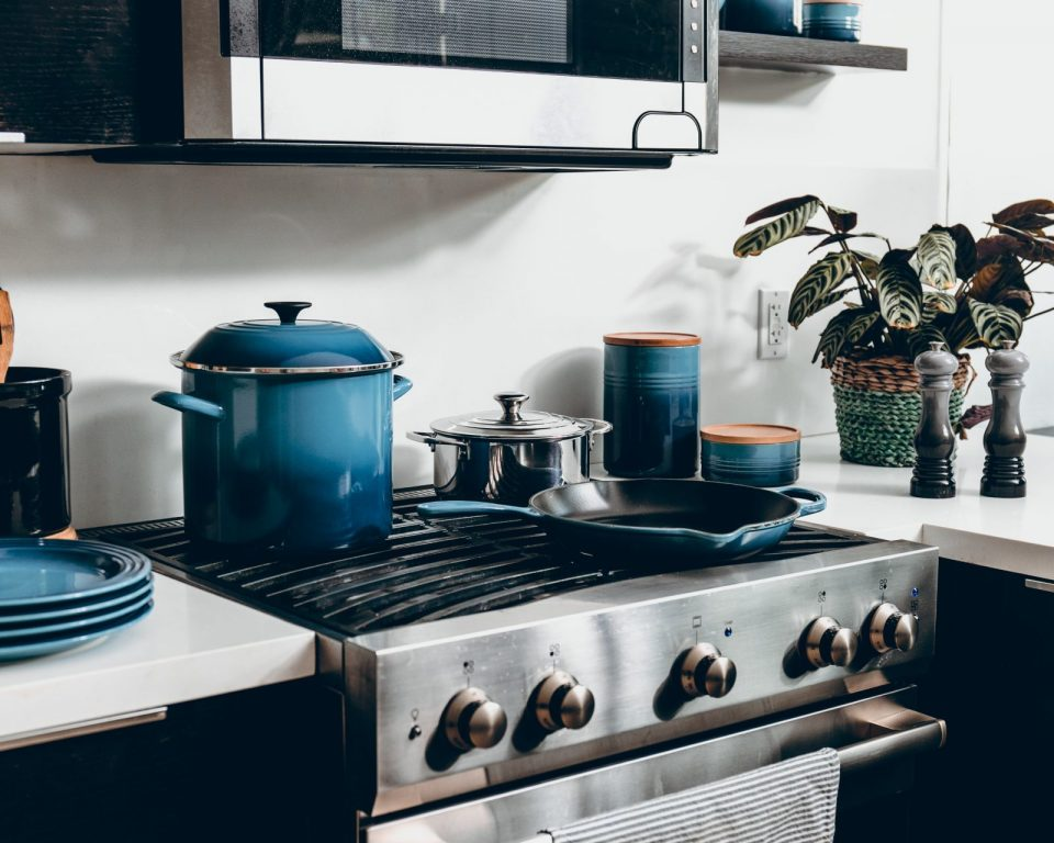 blue saucepans on stove
